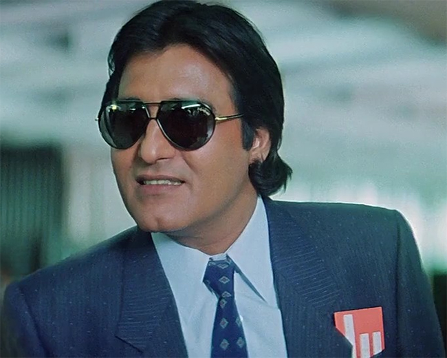 vinod khanna looking handsome in a coat and goggles