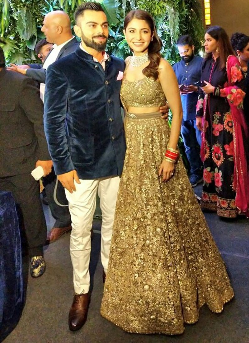 virat kohli and anushka sharma donned in sabyasachi outfit for their mumbai wedding reception