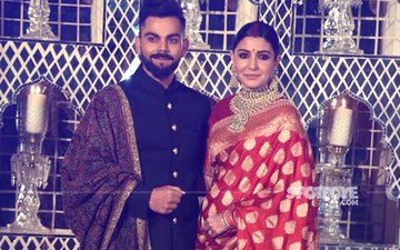 Virushka Reception: Anushka Sparkles In A RED BENARSEE SAREE, Virat Looks Regal In A Bandhgala With 18K GOLD BUTTONS