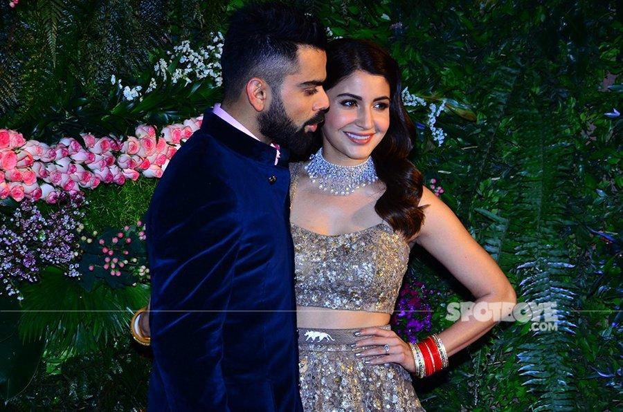 virat kohli with anushka sharma at thier wedding reception